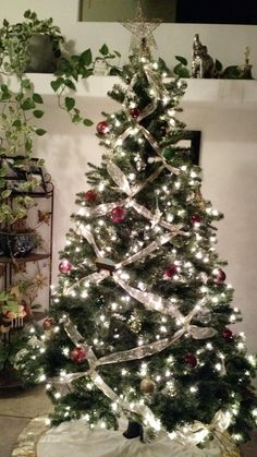 Criss crossed ribbons will bring an elegant look to your Christmas tree, and surprisingly, it's probably a lot simpler than you think.