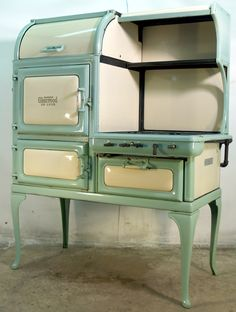 Insulated Glenwood Deluxe Retro Gas Antique Cook Stove in seafoam green & white.  Ours is similar only a gray and white Direct Action.