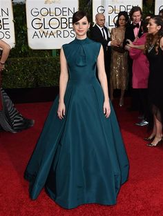 From the deep teal hue to the modest yet modern bodice, Felicity Jones' Dior couture 2015 Golden Globes gown was to die for -- making her one of the best-dressed women of the night.