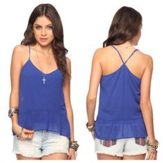 "Rory Beca Blue Spaghetti Strap Racerbck Tank A lightweight top from rory beca featuring a ruffled hemline and crisscross adjustable spaghetti straps. Preloved top, only worn once, still in excellent condition. V-neckline. Woven. Fully lined. Details: - 18"" approx. Length from high point shoulder to hem, 38"" chest, 24"" waist, 27.5"" sleeve length from high point shoulder - 100% polyester. ❌NO TRADES OR PAYPAL❌ PRICE IS FIRM EVEN IF BUNDLED Forever 21 Tops Tank Tops"