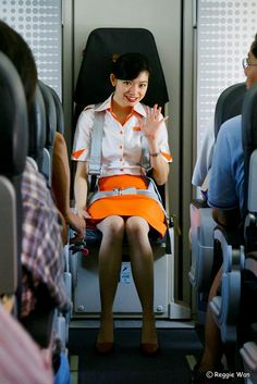 Firefly Stewardess, seated ready for landing. Phot by Reggie Wan
