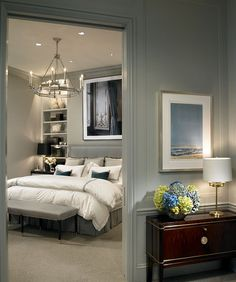 Soft shades of gray with white make this a very calm and relaxing bedroom.