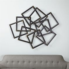Shop Multi Squares Metal Wall Decor.  Raw steel square frames scatter in dynamic array in this statement-making metal wall decor.  Brass soldering details each square with burnished miters, punctuating the whole composition with warm contrast.