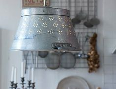 """Repurpose Colanders - 5 Things to Do - Bob Vila  """"Here's a project for the ambitious do-it-yourselfer: Turn a beat-up old colander into a shade for the pendant light in your country kitchen. When light streams through the holes in the colander, it produces quirky, amusing, conversation-starting effects on the walls. Alternatively, try out the same idea on a table lamp."""""""
