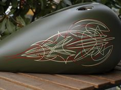 Army Green tank. Antique white and red pinstriping.