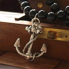 I have been searching for the longest time on what in the world I want my first tattoo to be. This is so perfect. I want the flower colored red to symbolize my mom and I want it either on my wrist, or on my shoulder. The anchor symbolizes my dad, because he was in the Navy.