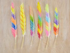 Fabric Marker Feathers: Colorful feathers are a very simple craft and interesting sensory activity with great visual results. Simply draw on white feathers with fabric markers. There is no right or wrong way, and you can choose whatever colors you'd like. For a more advanced method use Sharpie markers, then dilute the ink with a few drops of rubbing alcohol. #specialneeds #openended #inclusive #sensoryfriendly