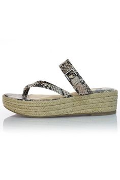 "Add a touch of wildlife to your summer sandal. This strappy wedge made of snakeskin embossed leather and braided raffia will have you looking exotic-chic. The heel of the wedge is 2"" high and gently slopes to 1 inch at the toe. The strap across the bridge of the foot is adjustable via a small silver buckle.    Heel height: 2""   Snake-Print Sandal by Klik Footwear. Shoes - Sandals - Platform South Carolina"