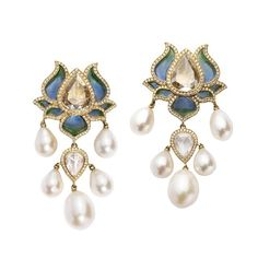 Timeless elegance is born. Read about @SidKas' #lotusflower earrings... @munnugempalace - imagli.com