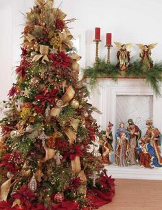 christmas tree decorating idea love the nativity set in the back