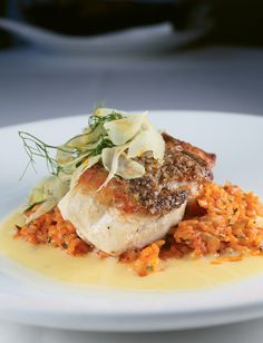 Golden tilefish with Lowcountry red rice, rock shrimp, shaved fennel salad, and citrus emulsion -- High Cotton Greenville, SC