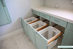 Same laundry room, laundry sorter area. Paint color: Benjamin Moore Wythe Blue.