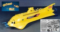 Seaview sub.  Here it is out of the box.  I had the VOYAGE playset, which came with a couple of divers, a whale, and two smaller craft; a mini-sub and a submersible crane.  The bright yellow Seaview may not have been exactly faithful to the show, but it was a beautiful, exciting toy.