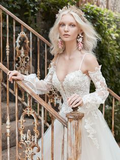 Maggie Sottero - STEVIE, A cold-shoulder bishop sleeve princess wedding dress for A) looking like you stepped out of a Pre-Raphaelite painting, and B) happy-crying with your betrothed.