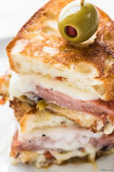 A Hot Muffuletta Sandwich dripping with cheese and packed with punch! I looove a good Muffuletta Sandwich!