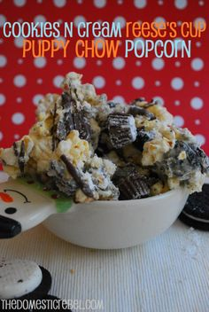 Cookies N Cream Reese's Cup Puppy Chow Popcorn. An indulgent, sweet and salty twist on the classic puppy chow treat! #christmas #dessert