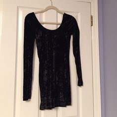 Free People velvet black body-con dress Worn once, perfect condition. Velvet, black, free people body con dress in size XS. Long sleeves and low back. Very comfortable. Free People Dresses Mini