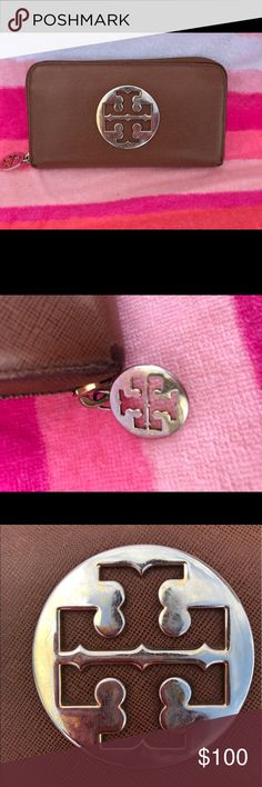 Tory Burch continental wallet •luggage color, used condition, approx 7 years old, wear and tear include scuffing and discoloration on hardware, edges discolored and worn, no malfunctions, zippers work great, interior all pockets in tact all zippers in tact. Tory Burch Bags Wallets