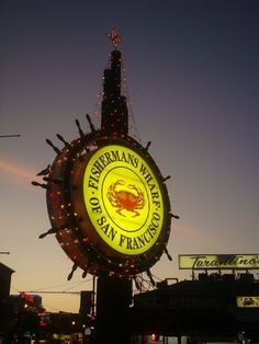 Fishermans Wharf sign at Christmas.  With Tarantino's in the background.