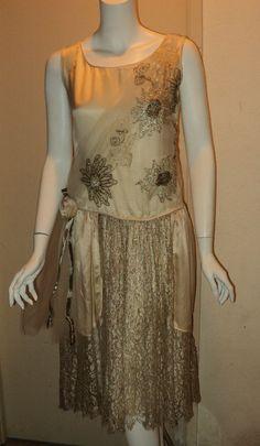 Antique 1920s Silk Satin Wedding Gown Flapper Metallic Lace Netting Ribbonwork Lame Larger Size Restored Original. $1,125.00, via Etsy.