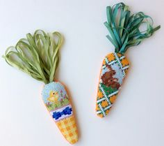 Ornaments, needlepoint carrots with ribbon tops