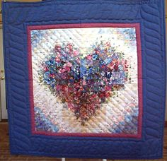 I'm not a big one for a heart pattern quilt, but isn't this Watercolor Quilt nice? http://www.amishquiltconnection.com/OnHand/heartehbl.JPG