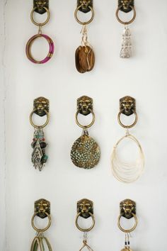 Design*Sponge Sneak Peek: I collect earrings everywhere I go because they are inexpensive and easy to transport. I display my favorites on these drawer pulls that I found for $3 at a hardware store. (earring storage)