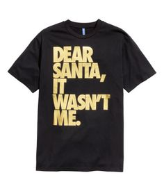 Long black T-shirt in jersey with a gold-tone text design. Holiday tee. | H&M Divided Guys