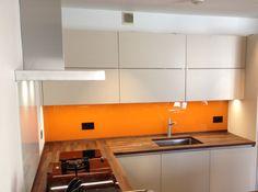 Orange glass splashback on ALNO kitchen with Spekva walnut worktops. By Phil Harflett Walnut Worktops, Alno Kitchen, Stylish Kitchen, Splashback, House Extensions, Kitchen Design, Orange, Bathroom, Glass