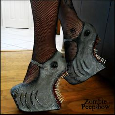 These ZombiePeepshow Shark Attack heel less shark wedges are hand painted and textured. Each shoe has mounted shark features, multiple sized spikes,