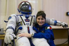 ESA astronaut Samantha Cristoforetti with the Sokol suit she will wear in the Soyuz spacecraft that will take her to the International Space Station on 23 November at 20:59 GMT (21:59 CET), together with Roscosmos commander Anton Shkaplerov and NASA astronaut Terry Virts.