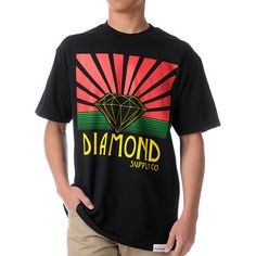 Let your rasta vibes shine in the Diamond Supply Co Shining tee shirt in black and rasta colors. The front graphic features red sun rays shooting out of the iconic Diamond logo in yellow with green lines below. Below it all is a yellow Diamond Supply Co script so everyone can see what's up. Keep your chalice Shining in this black and rasta tee from Diamond Supply Co.