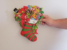 vintage 1980s CHRISTMAS STOCKING paper CUTOUT. toys. holly.