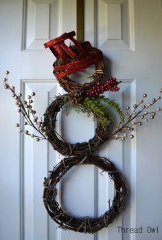 Ollie Snowman Door Hanger. $39.99, via Etsy.