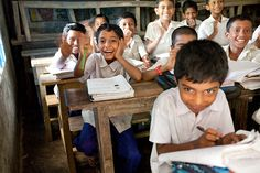 Students at No. 57 Narayanpur Government Primary School giggle while in class. These kids now have a clean charity: water project and latrines on school grounds.