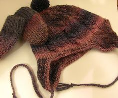 Knitted child's hat with matching mittens.