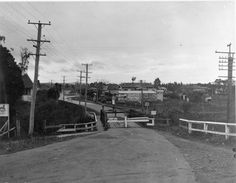 Henderson Heritage Trail B12. Newey's house was below the road, right of photo. Great North Rd, Henderson bridge over the Oratia Stream. 1932. Sir George Grey Special Collections, Auckland Libraries, 4-2500