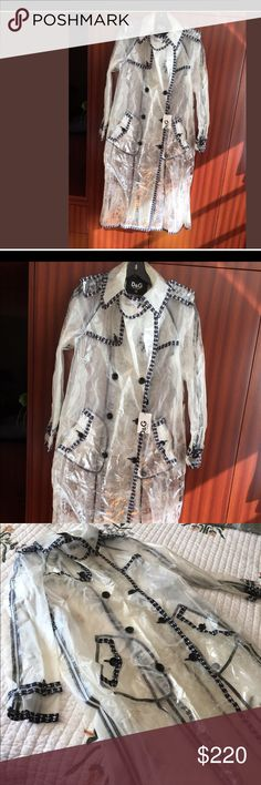 New D&G Rain Coat Size 42 Made in Italy Rain coat D & G material -transparent and frosted plastic decorated with Cotton Size 42 Retail $1616. Bought on sale for $299.99 D&G Jackets & Coats