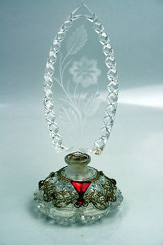 """Wonderful jeweled Morlee Crystal perfume bottle made in Czechoslovakia. It stands 7-1/2"""" with a beautiful filigree skirt containing faceted jewels"""