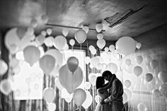 Sweet Engagement Pictures- maybe also done in color with balloons in wedding colors and couple in white...