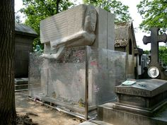 """The tomb of Oscar Wilde in Division 89 of the Père Lachaise cemetery in Paris, France, as it appeared on May This photo shows the glass barrier that has been erected around the tomb to discourage """"vandalism"""" from adoring fans. Oscar Wilde, Monuments, Père Lachaise Cemetery, The Happy Prince, Flanders Field, Famous Graves, Creative Visualization, Most Visited, Bury"""