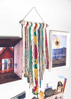 Bohemian wall hanging with indian sari kantha strips and cotton rope fringe hanging from natural driftwood stick. Handmade unique vintage bohemian home decor