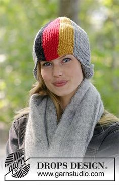 3ec6f0c6d5bd4 Ready to Cheer - Knitted hat with flag in DROPS Karisma. The piece is worked