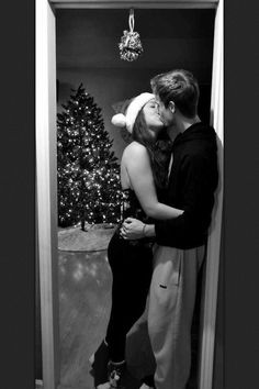 Christmas Tree, Jingle Bell Socks, Sweatpants, and Kissing Under the Mistletoe We need a pic like this!