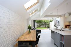 A beautiful classic pitched to hip roof kitchen extension in Tooting. The rear part of the extension was built out far enough to accommodate not only skylights down the side . Kitchen Extension Side Return, Kitchen Diner Extension, Open Plan Kitchen, Kitchen Living, New Kitchen, Kitchen Ideas, House Extension Design, Extension Ideas, Side Extension