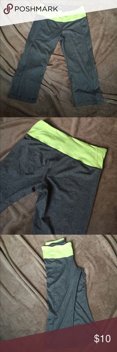 Capri Crop Leggings These pants are great for running, lifting or just everyday wear. Super comfortable thick but breathable material- good quality! Gray with neon yellow waist band. Pants Leggings