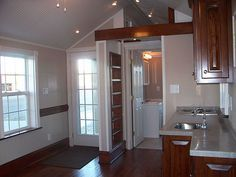 $24,000 plus delivery--The Holly Pond Cottage is really beautiful inside and out with lots of light and yet a real cozy secure feeling inside. Notice the pressure treated timbers used for the foundation frame. 2X6 exterior stud walls. R19 plus (with extra pocket airspace) in floor, walls, and ceiling.