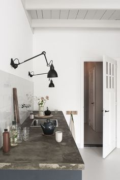 Black wall mounted task lighting in the kitchen black Lampe Gras wall lights kitchen lighting Kitchen of the Week: The Curtained Kitchen, Dutch Modern Edition - Remodelista Kitchen Lamps, Kitchen Chandelier, Home Decor Kitchen, Decorating Kitchen, Studio Kitchen, Kitchen Table Light, Kitchen Ideas, Kitchen Decorations, Rustic Chandelier