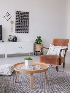 Mid-century armchairs and a DIY daybed in a Finnish home in a converted factory / Projekti Verkaranta, Jutta K.