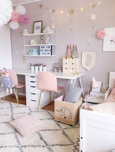We love this kids' room decor! Scandinavian inspired with beautiful pin hue. Gorgeous girl's bedroom